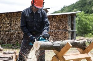 using chainsaw with safety gear